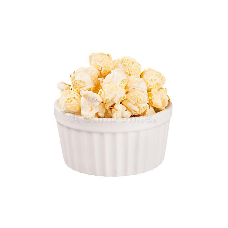 Golden popcorn with in white ceramics bowl isolated on white background. stock image