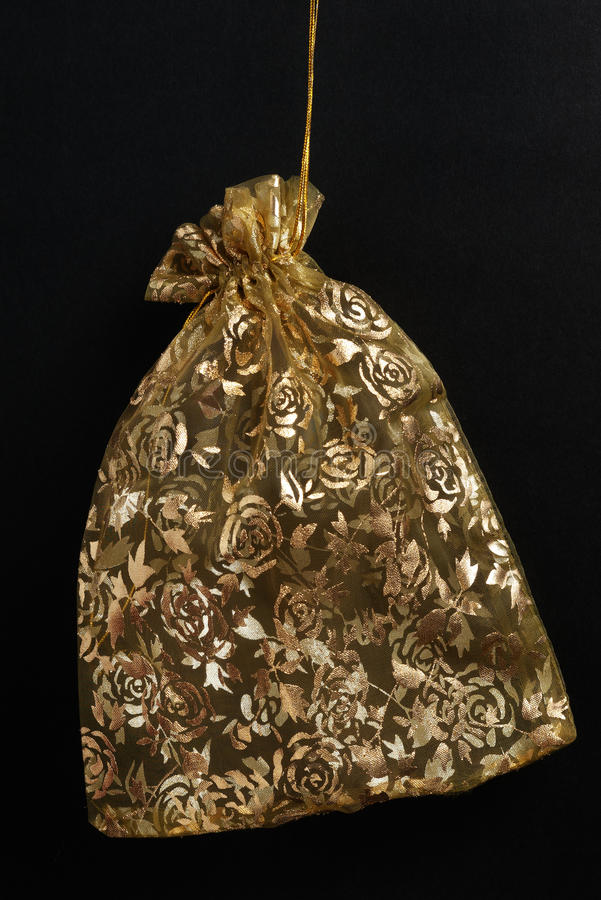 Download Golden Pouch On Black Stock Image - Image: 15533101