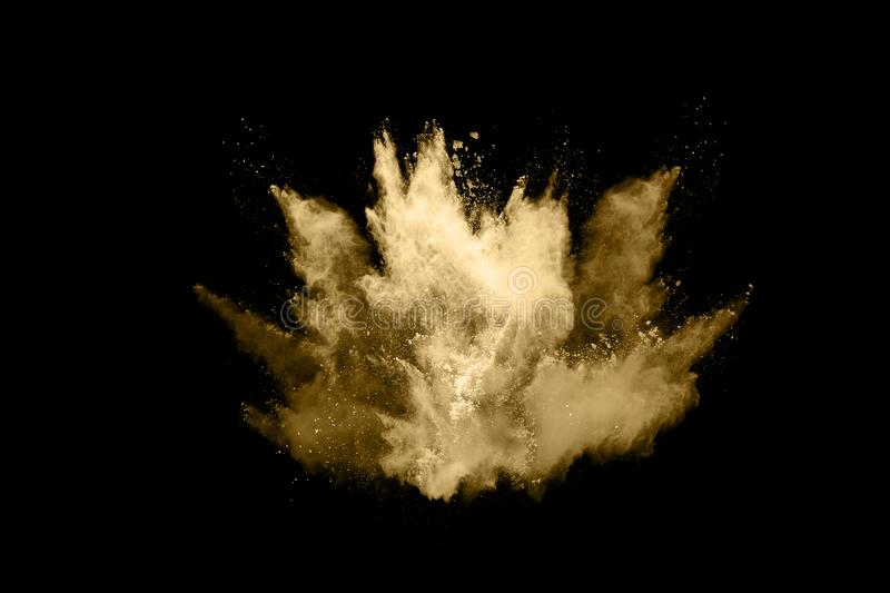 Golden powder explosion on black background. Freeze motion. Golden powder explosion on black  background. Colored cloud. Colorful dust explode. Paint Holi stock images
