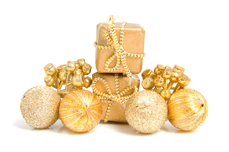 Golden presents and decoration. For christmas over white background royalty free stock photo