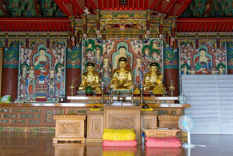 Golden principle Buddha images in Main hall of Haedong Yonggungsa Temple. BUSAN, SOUTH KOREA - JULY 20, 2017 : Golden principle Buddha images in Main hall of royalty free stock photos