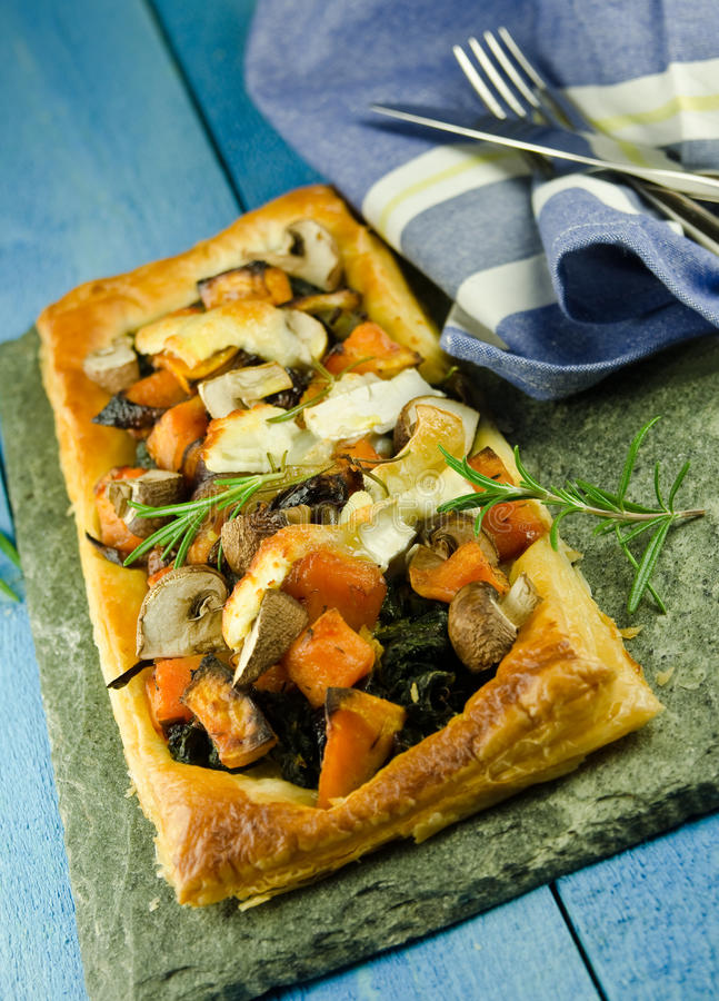 Golden puff pastry with roasted vegetables royalty free stock images