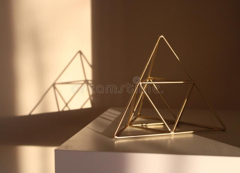 A golden pyramid. And the shadow royalty free stock photo