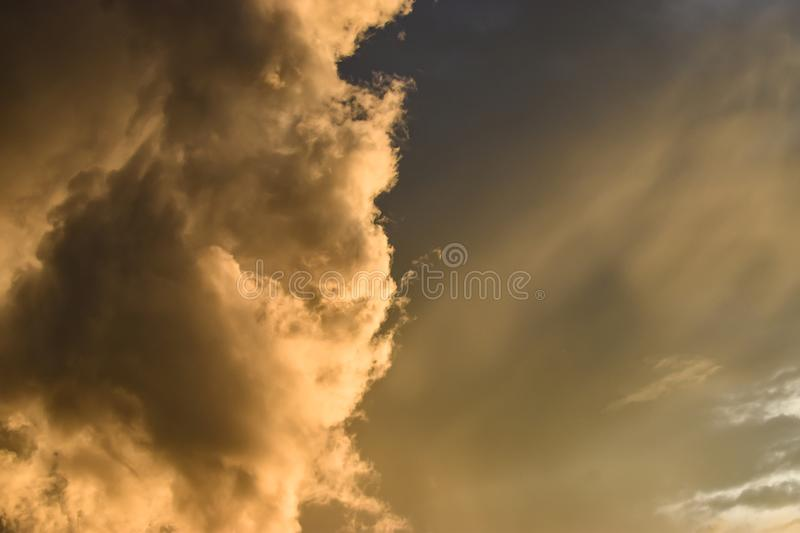 golden rays in the clouds and sky, when the sun sets royalty free stock image