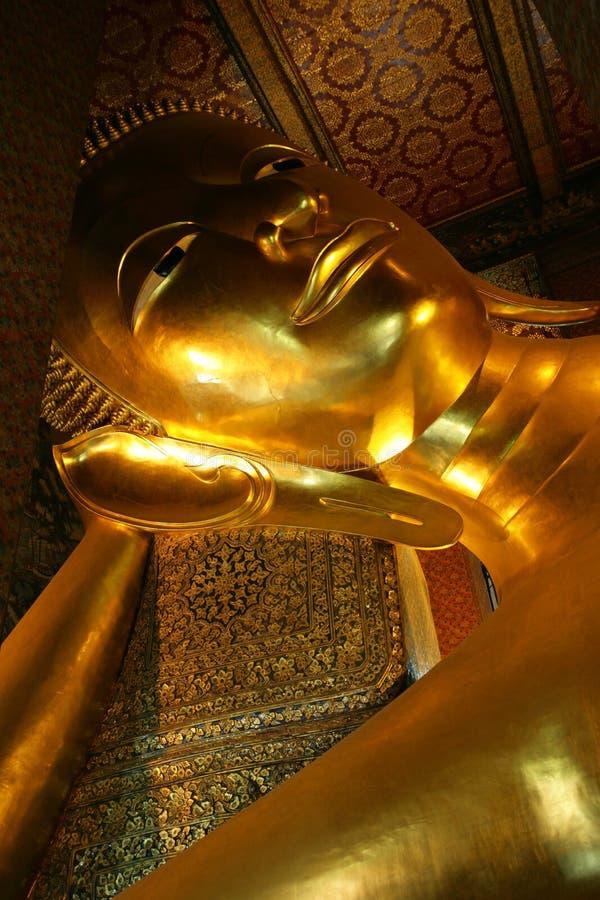 Golden reclining Buddha statue royalty free stock photo