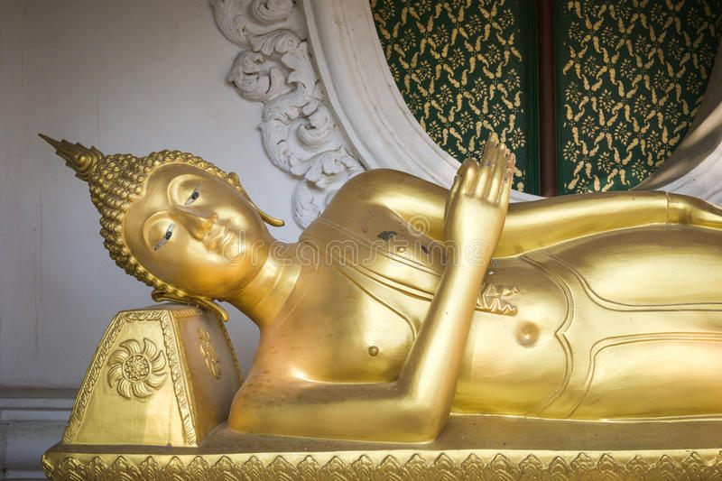 Golden reclining Buddha statue in buddhist temple in Thailand stock images