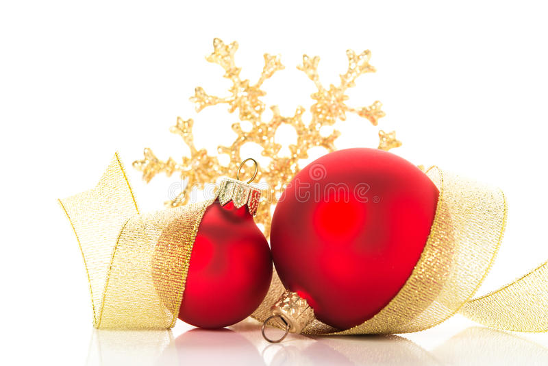 Golden and red christmas ornaments on white background. Merry christmas card. Winter holidays. Xmas theme royalty free stock image