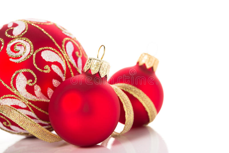 Golden and red christmas ornaments on white background. Merry christmas card. Winter holidays. Xmas theme stock image