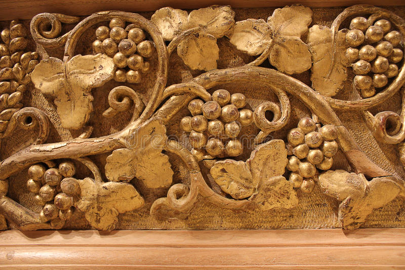 Golden relief of grape wine. Horizontal golden relief of grape wine royalty free stock photography