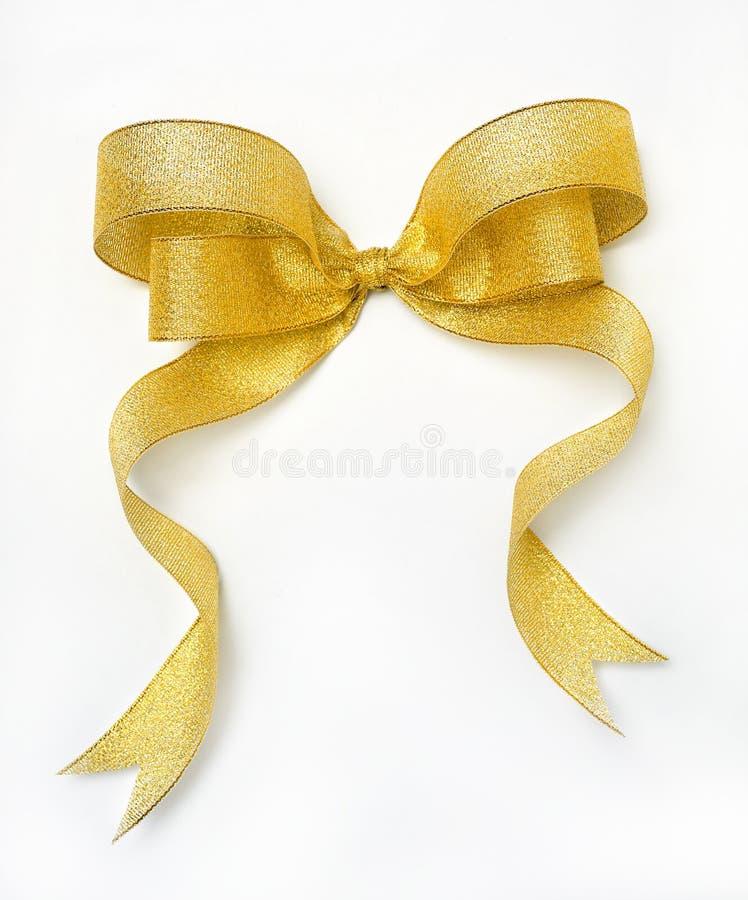 Golden ribbon. Isolated on white background stock image