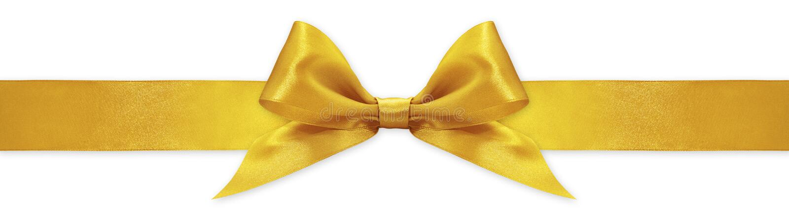Golden ribbon bow isolated on white background, for event or gift package stock image