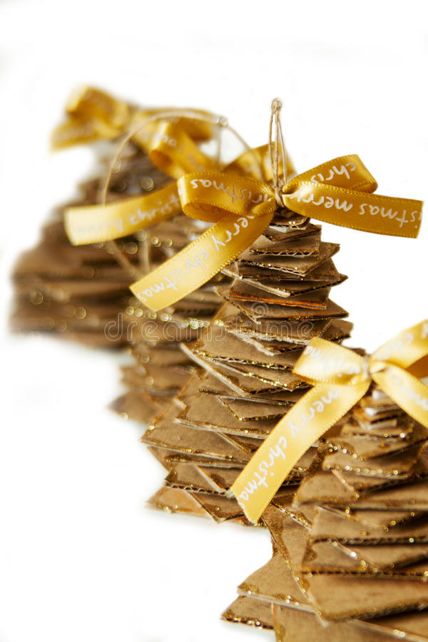 Golden ribbon and cardboard handmade Christmas tree stock images