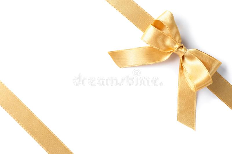 Golden ribbons with bow isolated on white background. Gift concept royalty free stock image