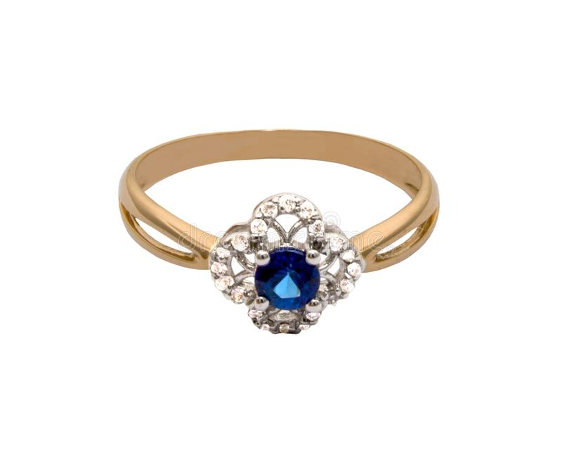 Golden ring with big sapphire and diamonds stock image