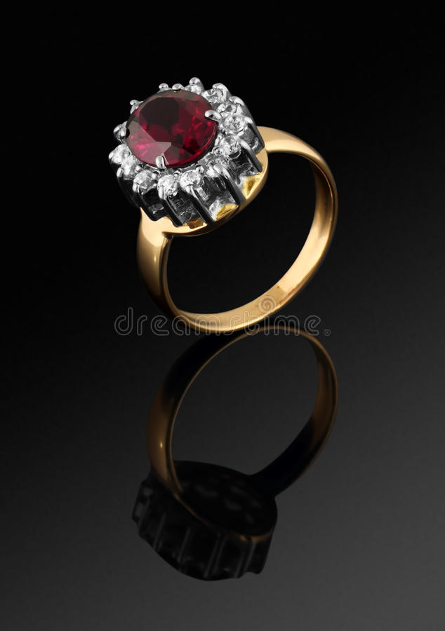 Golden ring with diamonds and gem on black royalty free stock images