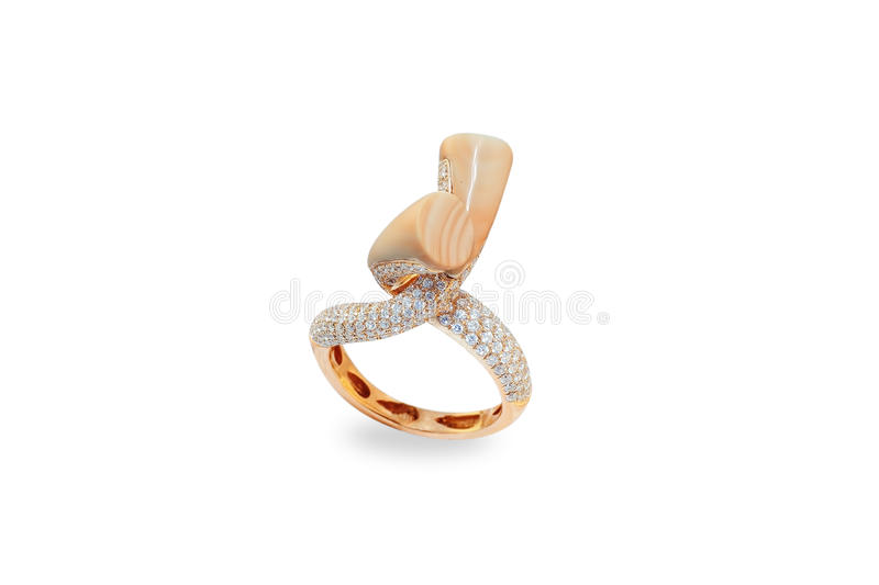 Golden ring with jasper and diamonds royalty free stock photo