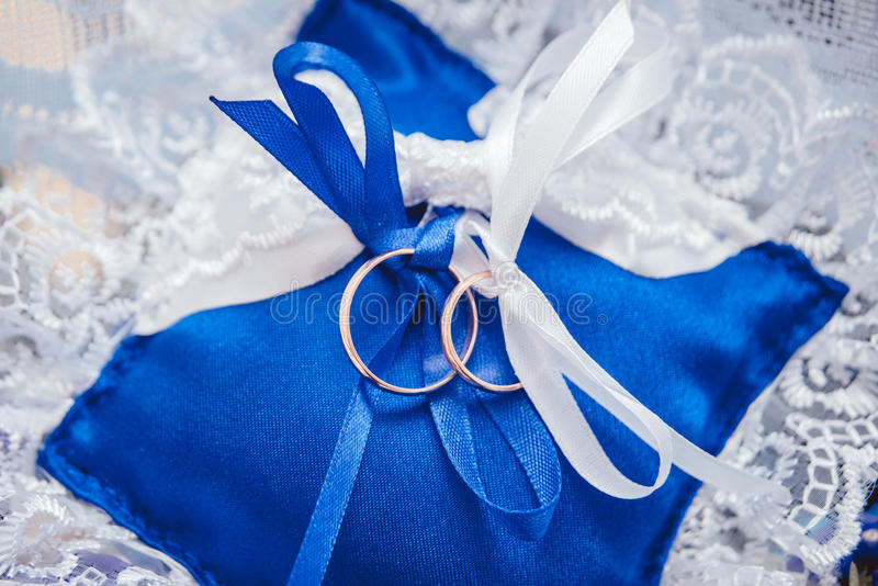 Golden rings. On the pillow. Wedding royalty free stock photo