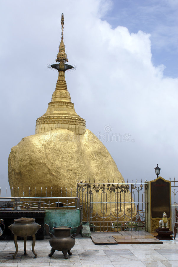 Golden rock and shrine stock images