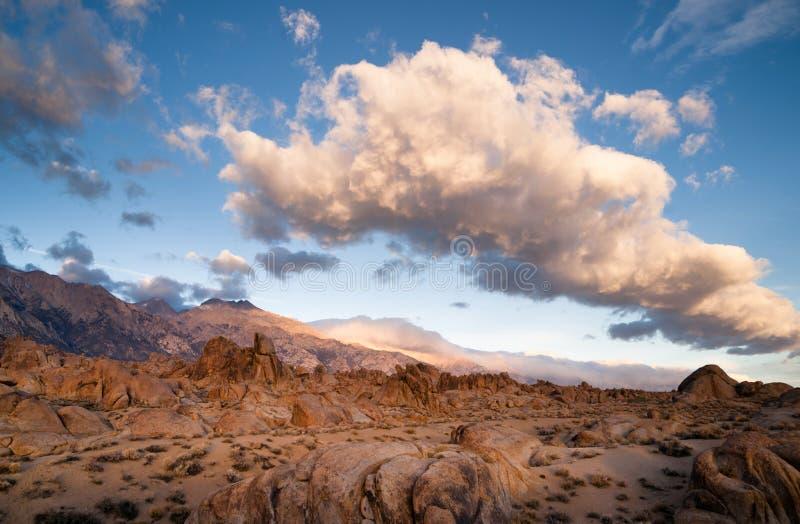 Golden Rocks Alabama Hills Sierra Nevada Range California. A big beautiful white cloud mass passes over the Alabama Hills in California royalty free stock image