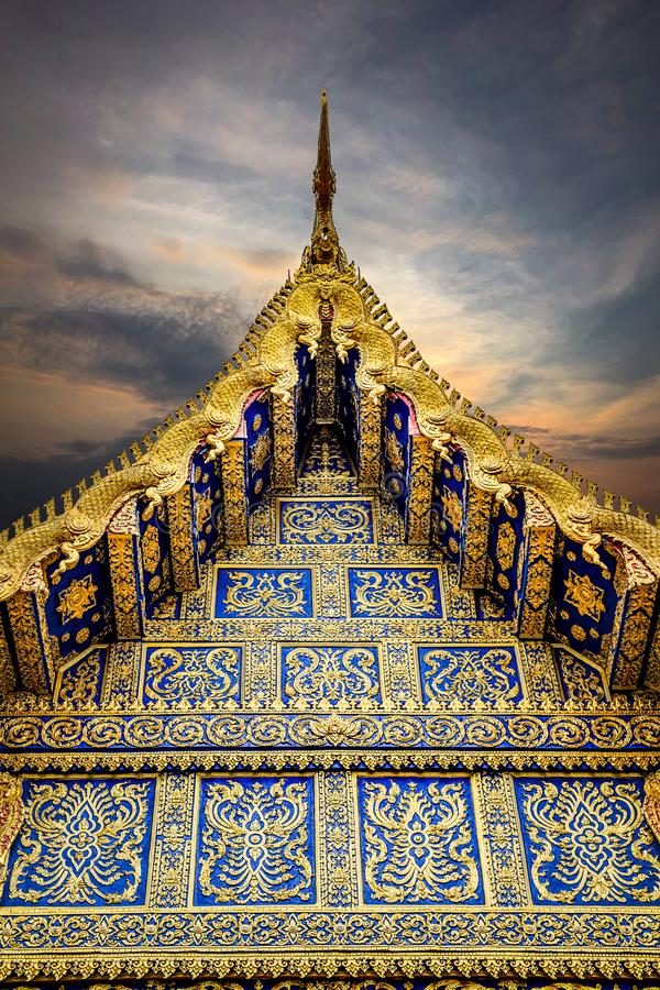 Golden roof of Thai temple with the Twilight sky stock photos
