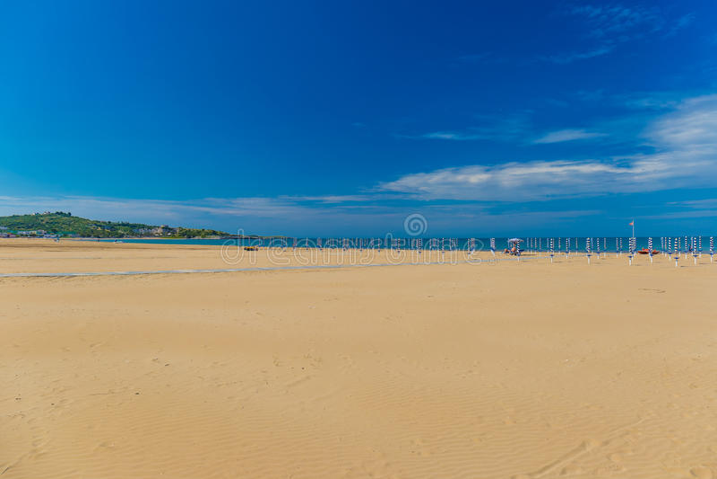 Golden sand beach of Vieste, Gargano peninsula, Apulia, South of Italy. Golden sand beach of Vieste, sunny day, Gargano peninsula, Apulia, South of Italy stock images