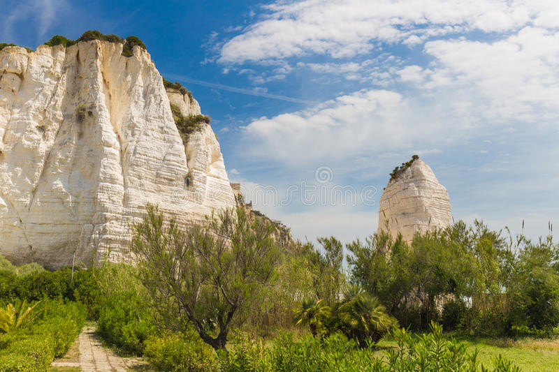 Golden sand beach of Vieste with Pizzomunno rock, Gargano peninsula, Apulia, South of Italy. Golden sand beach of Vieste with Pizzomunno rock, typical white stock photography