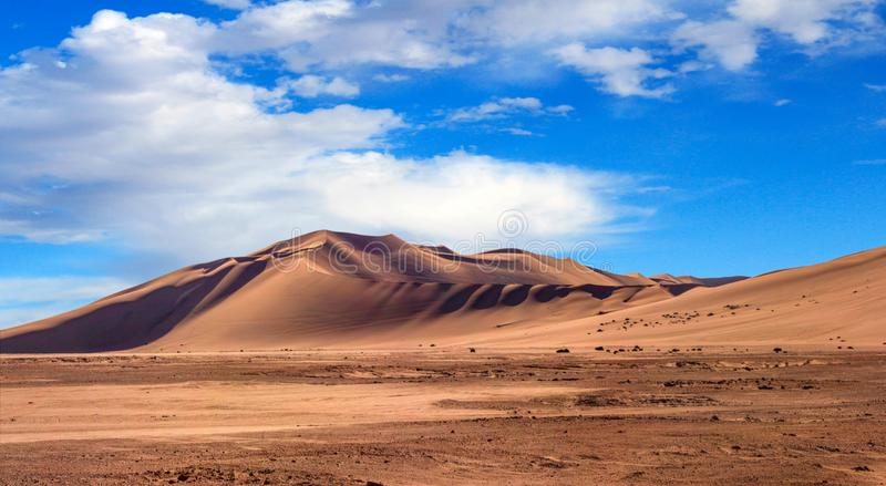 Golden sand dune 7 and white clouds on a sunny day stock images