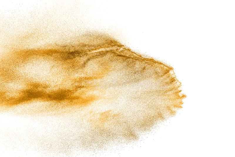 Golden sand explosion isolated on white background. Abstract sand cloud. Gold sand splash against on clear background. Sandy fly wave in the air stock image