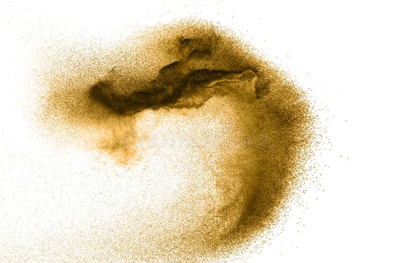 Golden sand explosion on white background. royalty free stock photos