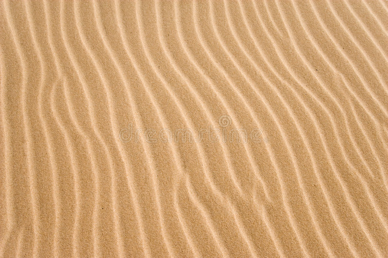 Golden sand grooves royalty free stock images