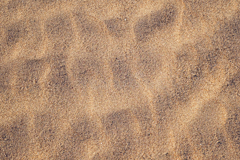 Golden sand texture. At the beach stock images