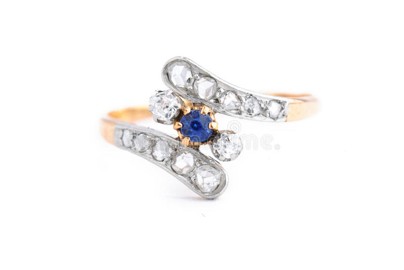 Golden sapphire ring with diamonds stock photo