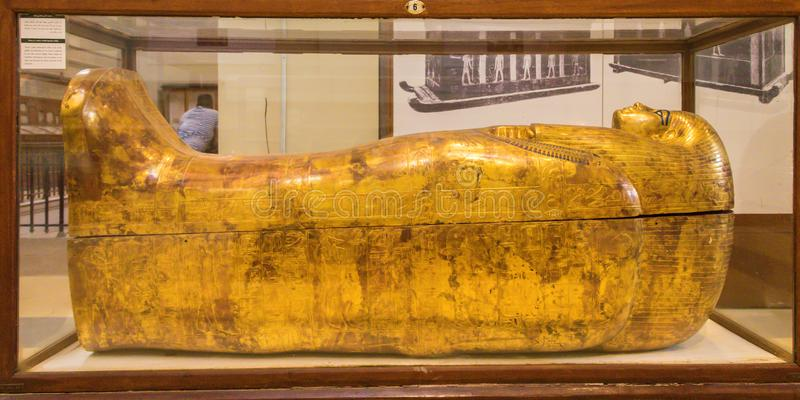 Golden sarcophagus of Egyptian pharaoh royalty free stock images