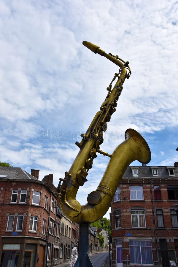 The golden saxophone sculpture in memory of Adolphe Sax stock image