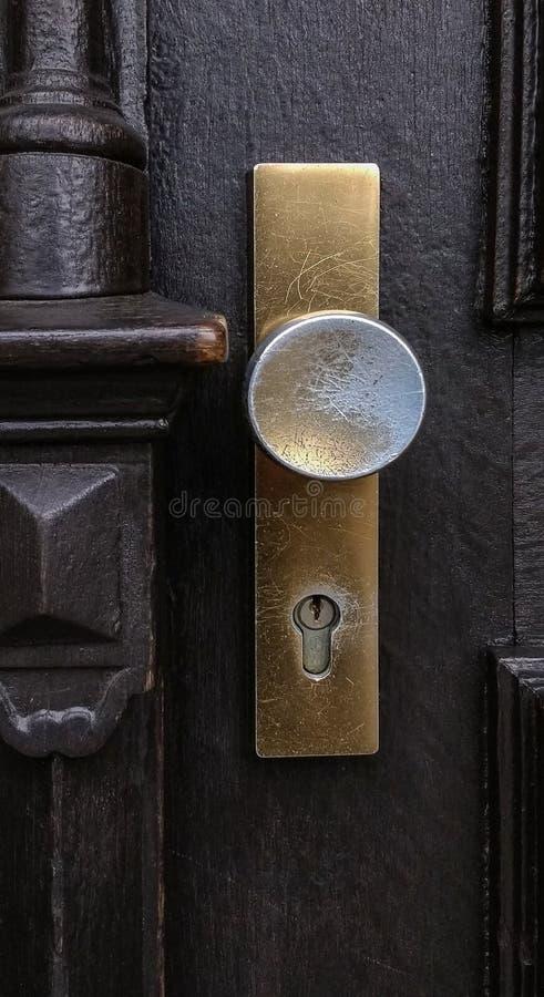 Golden scratched doorknob stock image