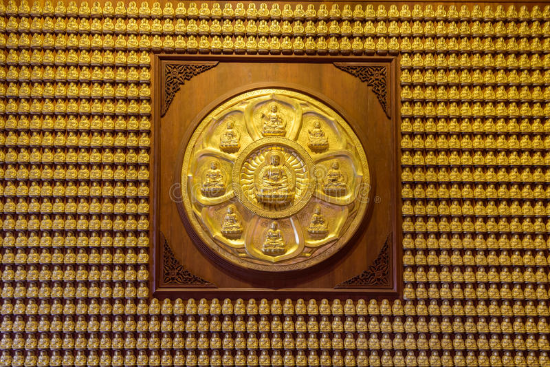 Golden Sculpture wall in Dragon Temple Kammalawat stock images
