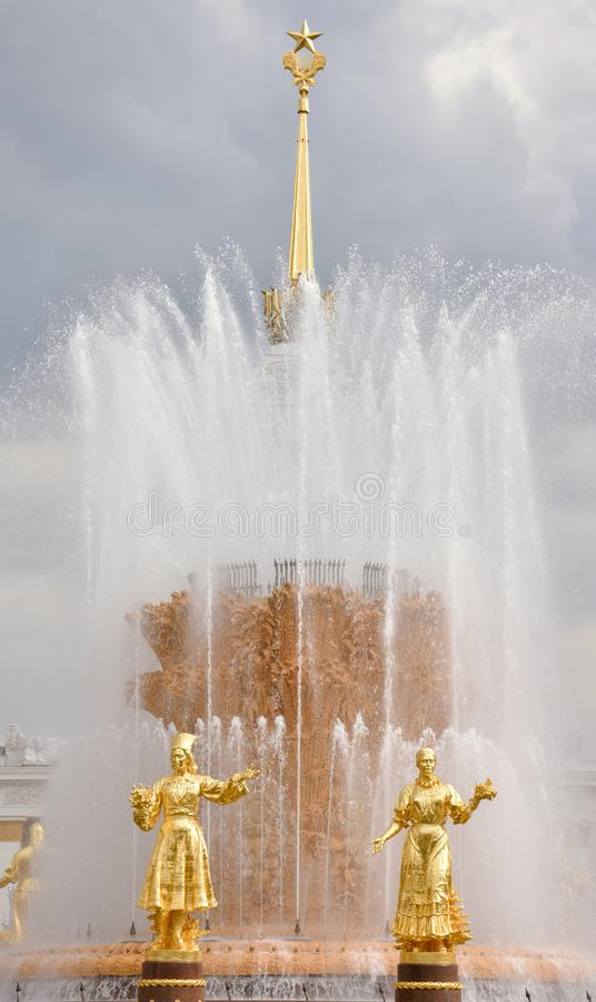 Golden sculptures of the fountain Friendship of Peoples royalty free stock image