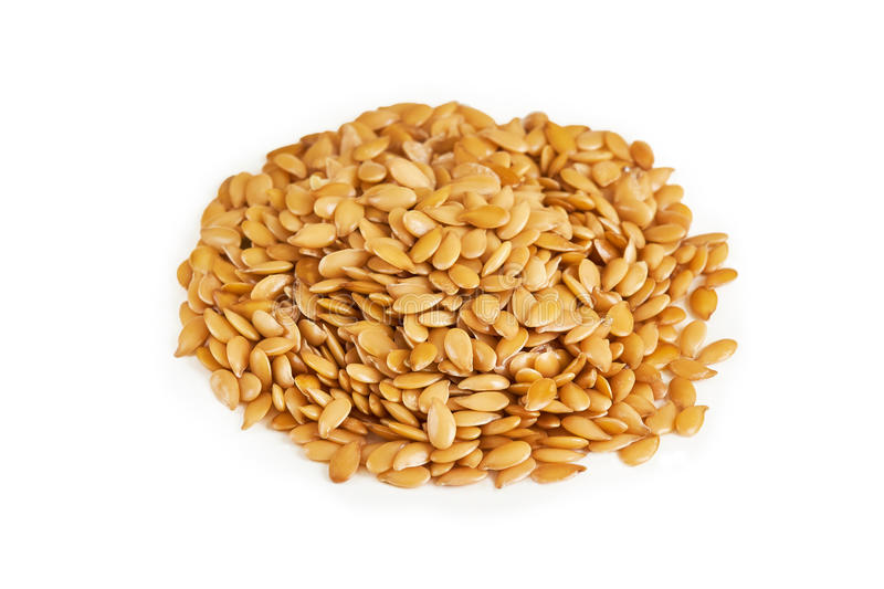 Golden sesame seeds. Pile of golden sesame seeds isolated on white background stock photo