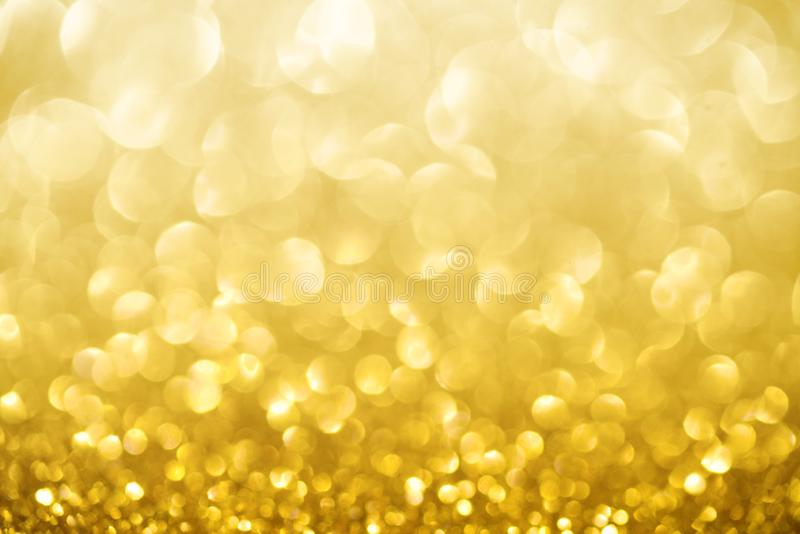 Golden shimmer glitter texture confetti designed background.  royalty free stock photos