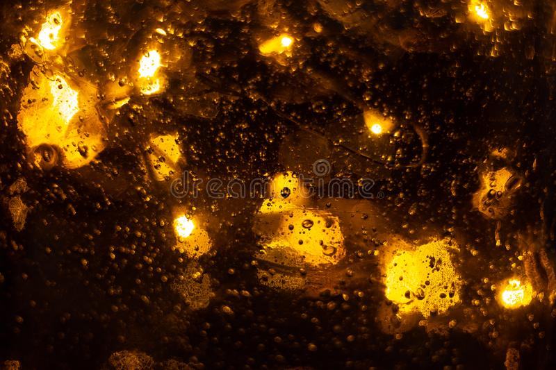 Golden shiny background with bokeh lights. Yellow glittering blurred texture. Lights and bubbles abstract defocused background stock photos