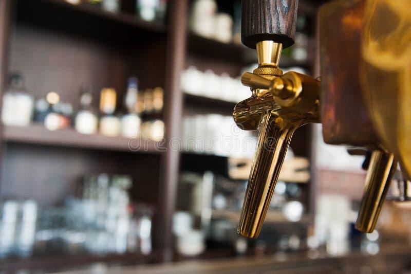 Golden beer tap. Golden shiny beer taps in beer bar stock photo
