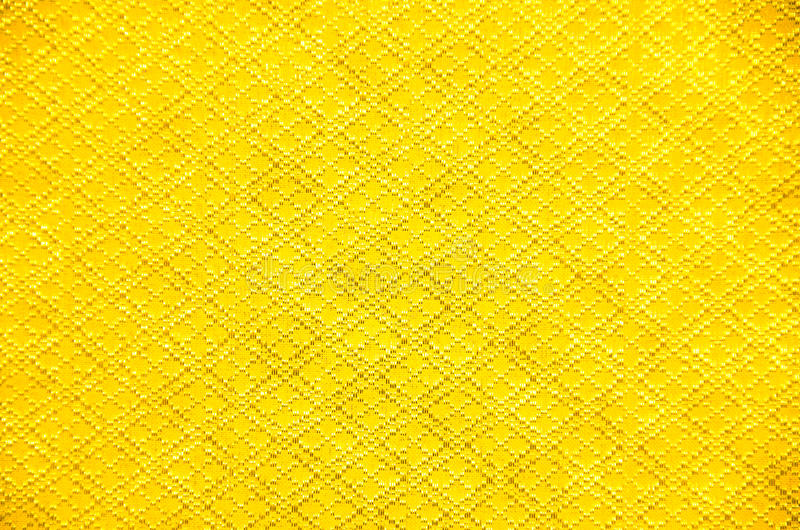 The golden silk. Fabric imported textiles by hand stock image