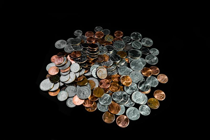 Golden and silver american dollar coins background. Coin background. Pennies/Quarters/ Cents stock images