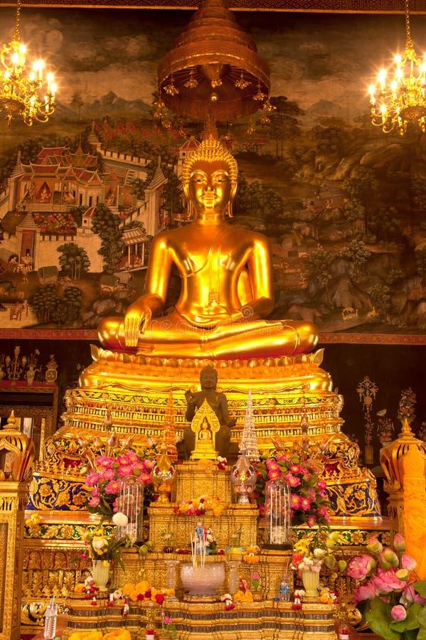 Golden sitting buddha in Thai church. stock photos