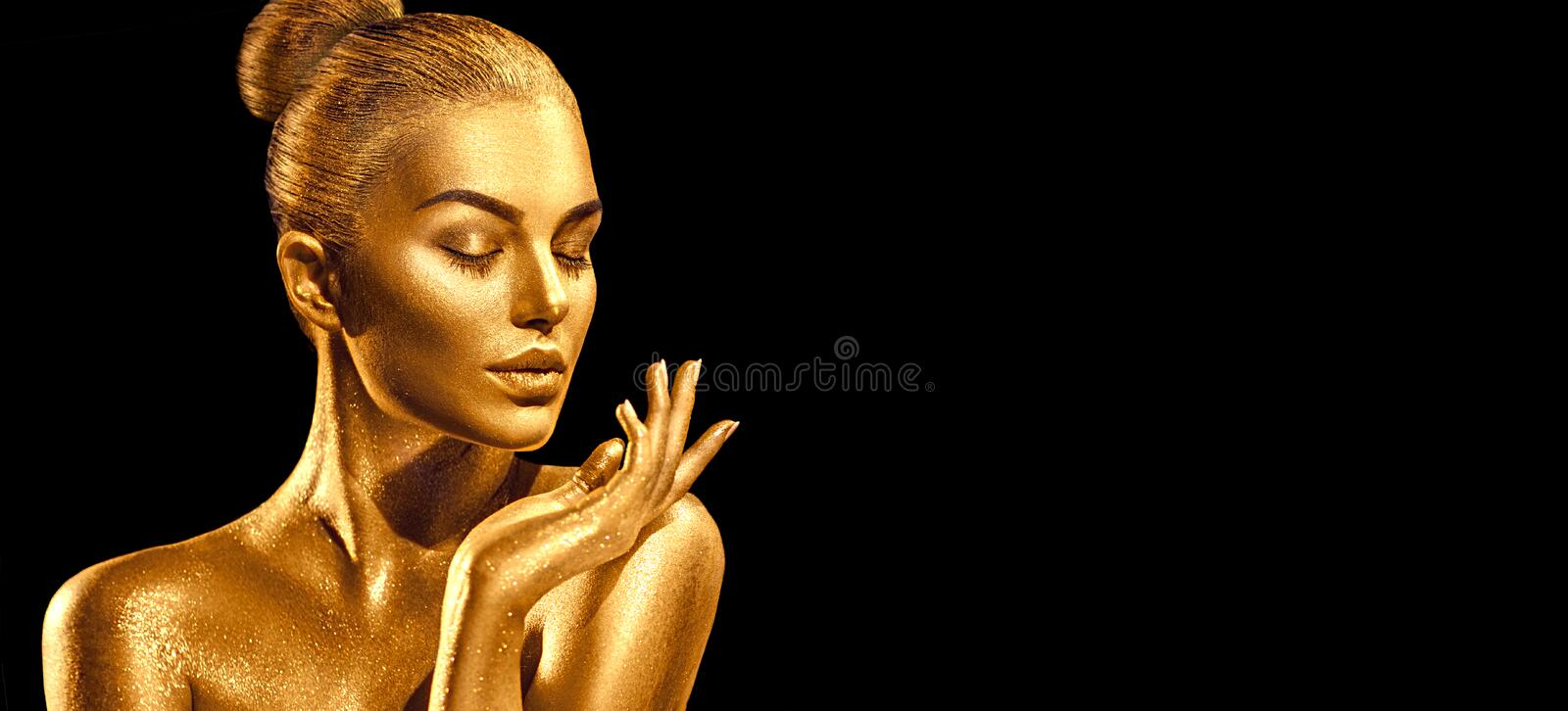 Golden skin woman portrait closeup. model girl with holiday golden shiny professional makeup. Metallic body. Golden skin woman portrait closeup. model girl with stock image
