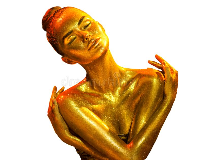 Golden skin woman portrait closeup. model girl with holiday golden shiny professional makeup. Golden metallic body royalty free stock images