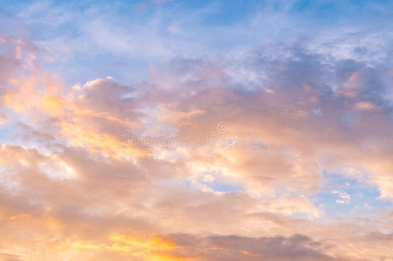 Golden sky and clouds with silver lining. Golden evening sunset sky and clouds with beautiful silver lining royalty free stock images