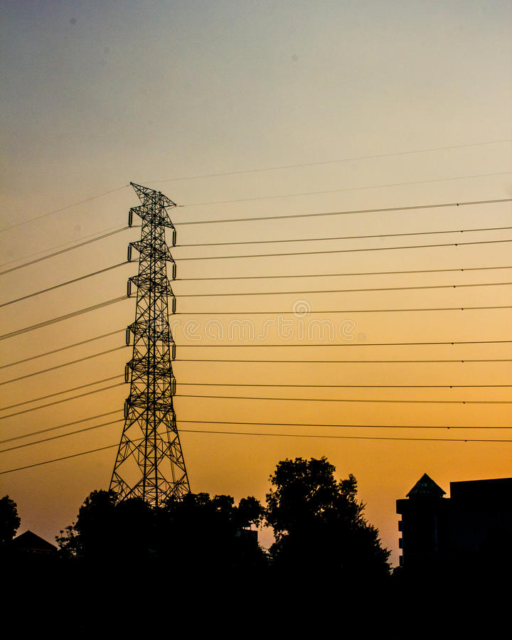 Golden Sky with electricity post stock photography