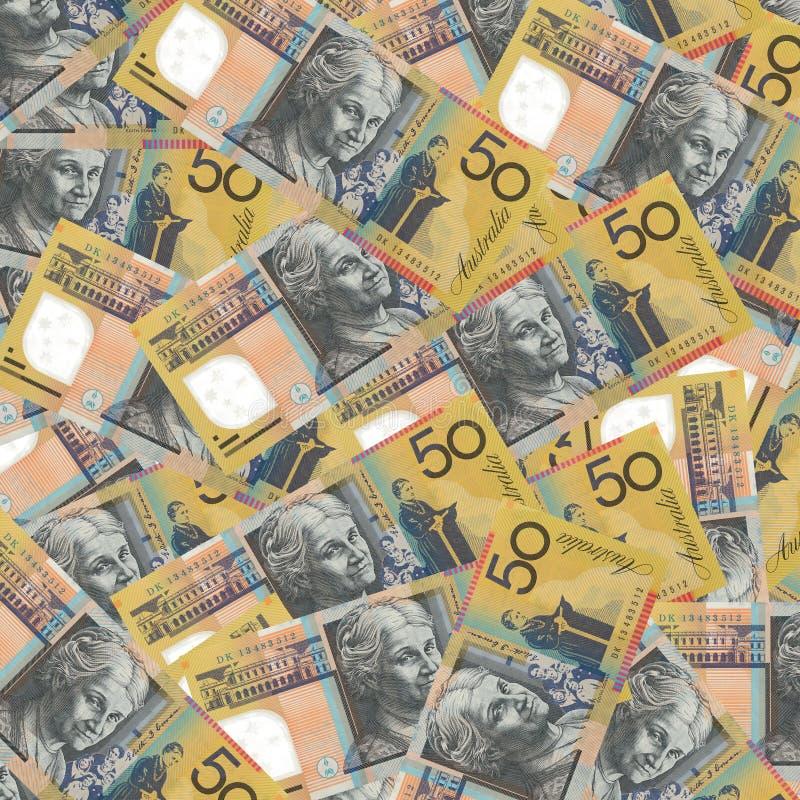 Australian 50 dollar. Golden and sliver bitcoins on pile of Australian 50 dollar banknotes closeup background stock photos