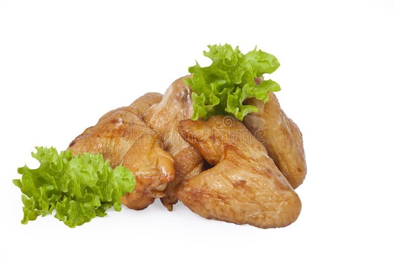 Golden smoked wings. Isolated on white background royalty free stock images